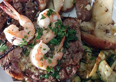 Surf & turf with ribeye steak and gulf shrimp